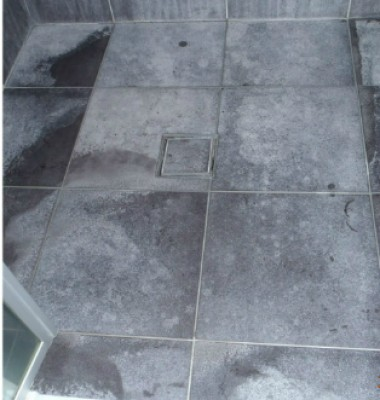 close up of dirty tiles and grout in shower