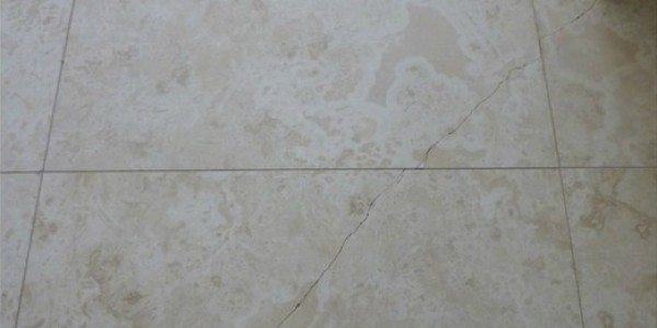 Travertine Cracked tile before it is repaired.